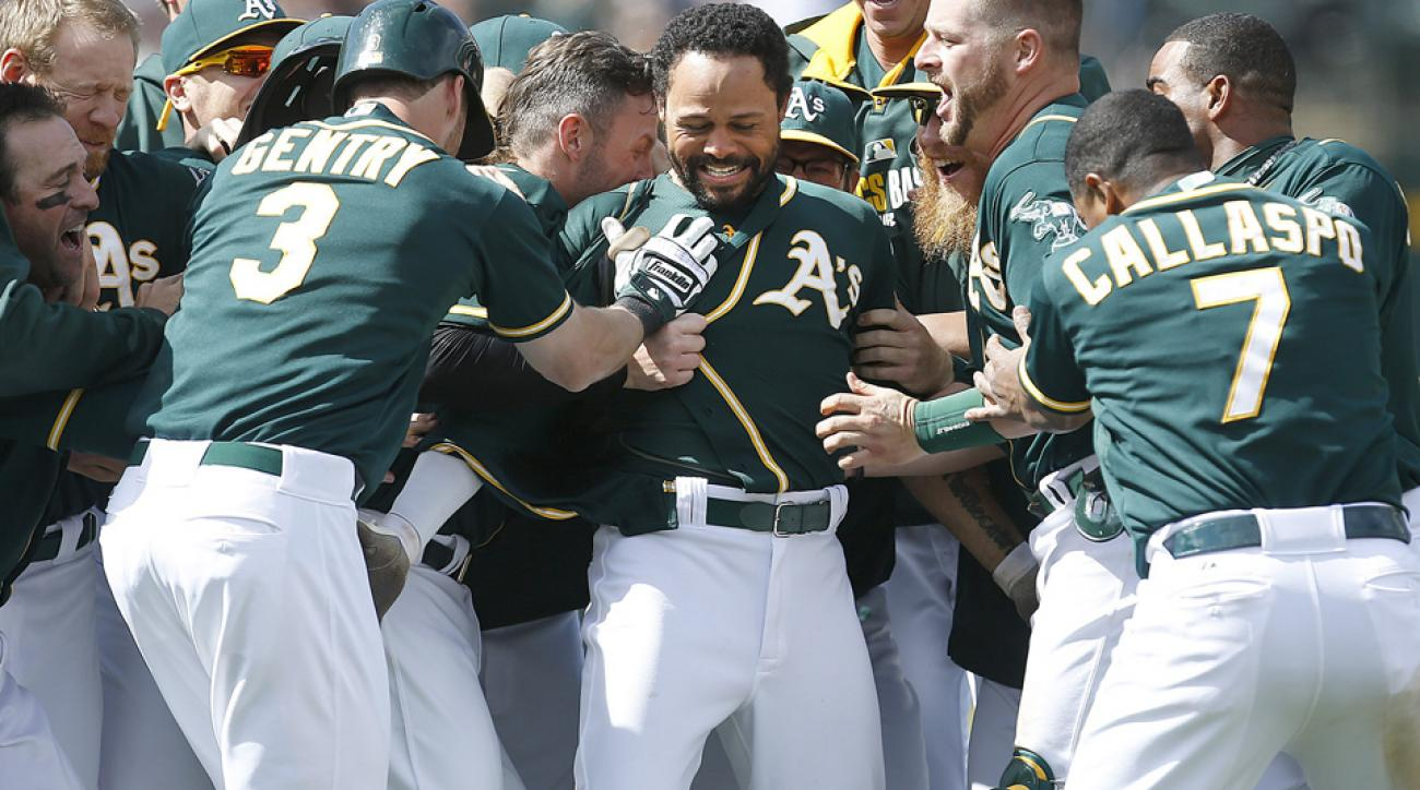 Coco Crisp (center) had a walk-off hit last Saturday that helped Oakland go 5-2 for the week, with series wins against the Rangers and Red Sox.