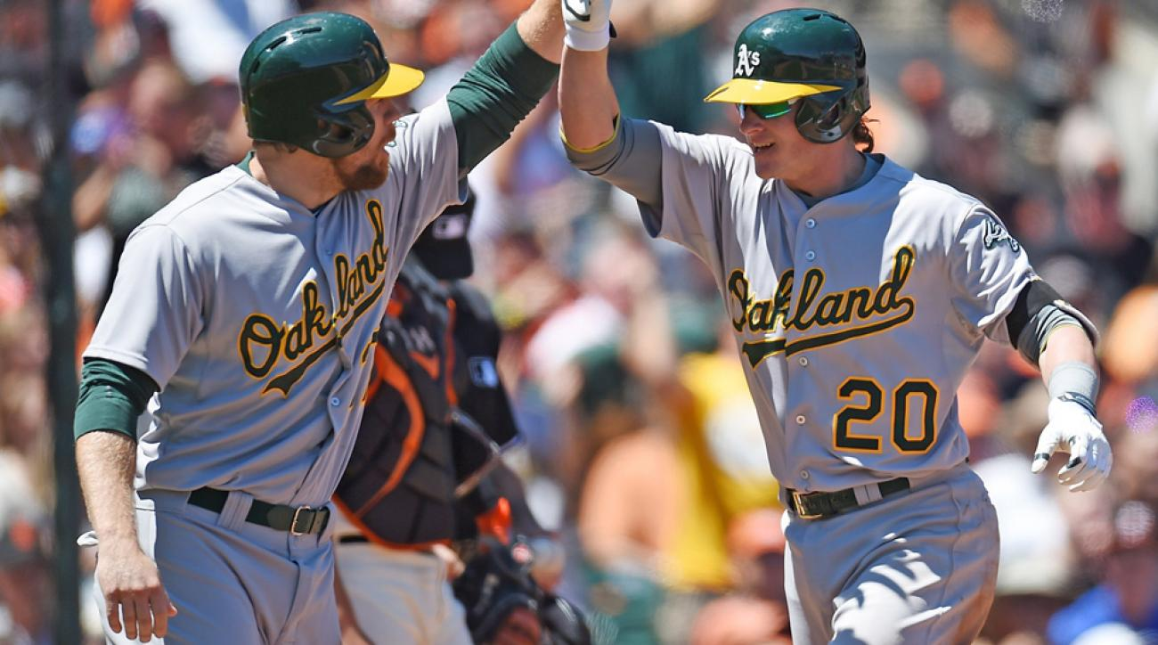 Brandon Moss (left), Josh Donaldson and the Oakland Athletics have the most wins and best record in baseball heading into the season's second half.