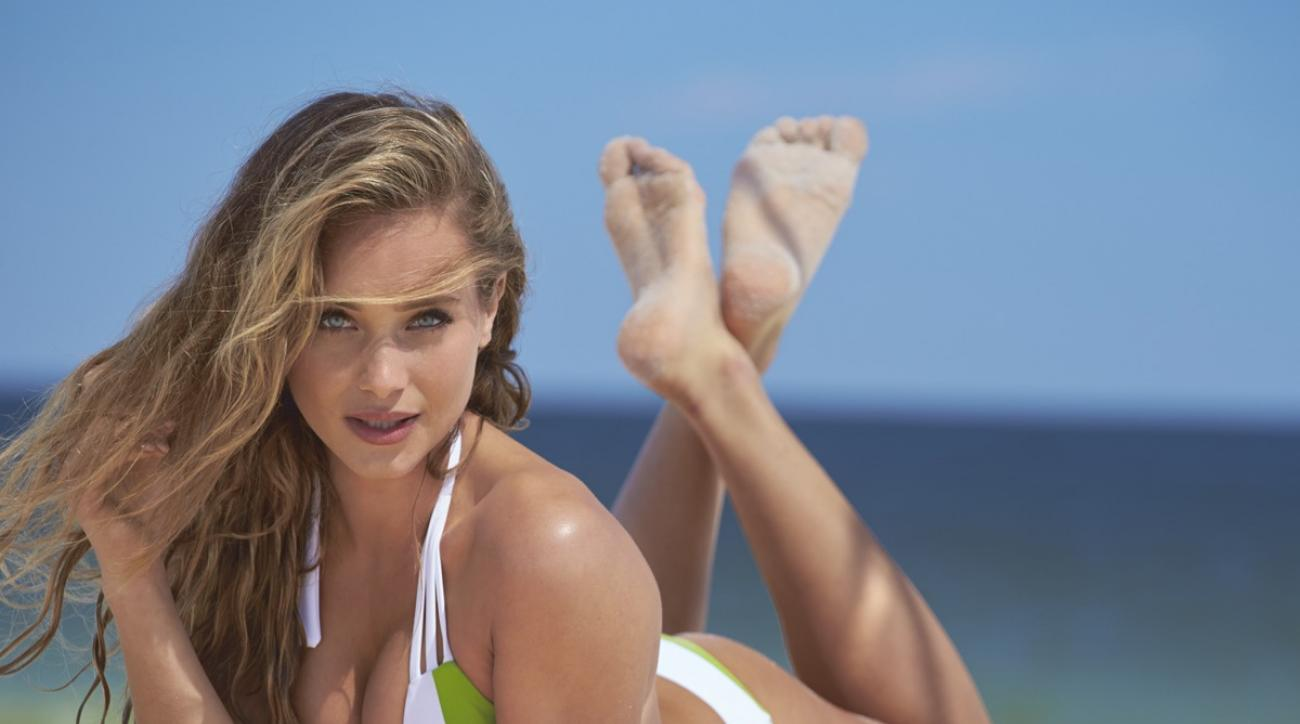 Hannah Davis was photographed by Ben Watts at the Jersey Shore. Swimsuit by Swimsuit by Elizabeth Southwood for Sauvage Swimwear, Surfboard by Grain Surfboards.