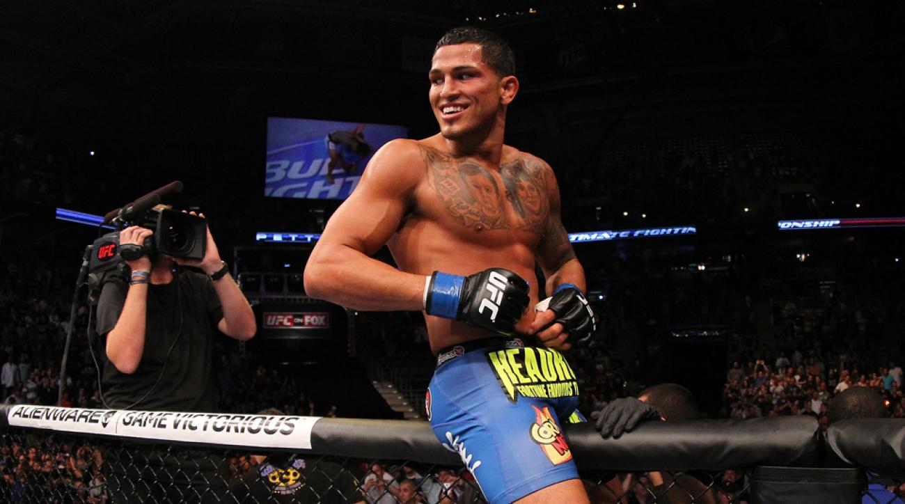 Anthony Pettis celebrates after defeating Benson Henderson in their UFC lightweight championship bout at BMO Harris Bradley Center on August 31, 2013 in Milwaukee, Wisconsin.