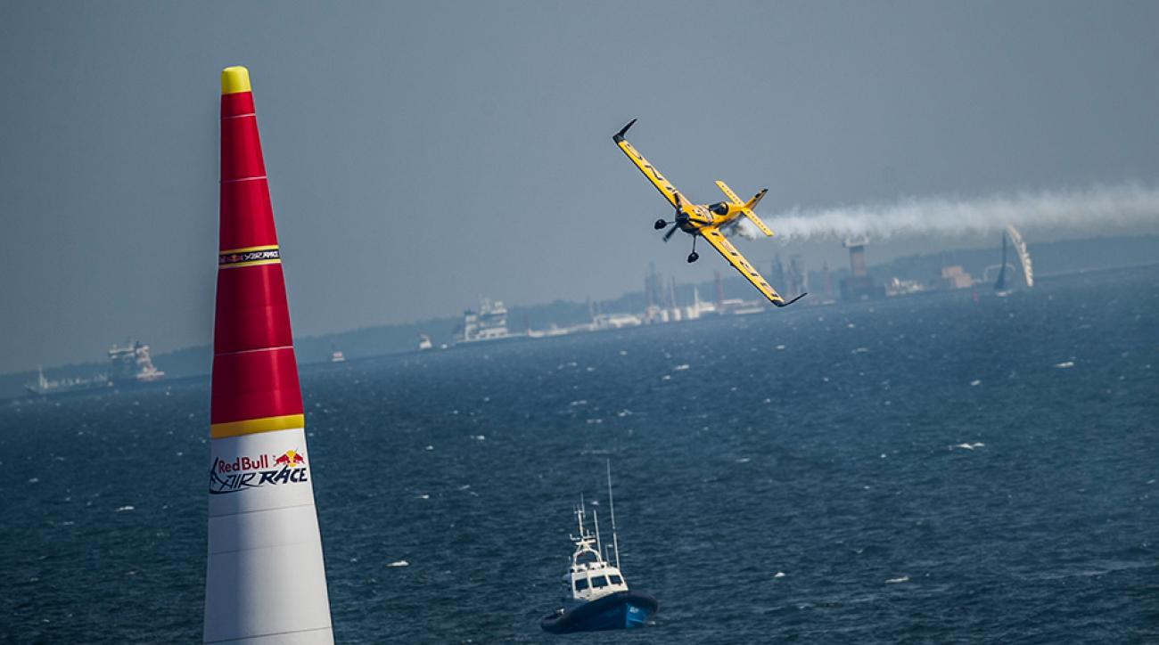 Nigel Lamb of Great Britain performs during training for the fourth stage of the Red Bull Air Race World Championship in Gdynia, Poland on July 25, 2014.