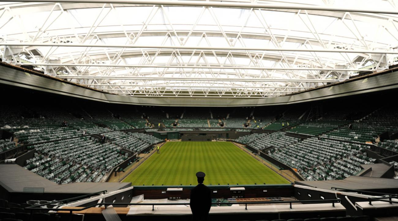 A security guard looks over the new retractible roof on Centre Court at the Spring Press conference at the All England Lawn Tennis Club Wimbledon.