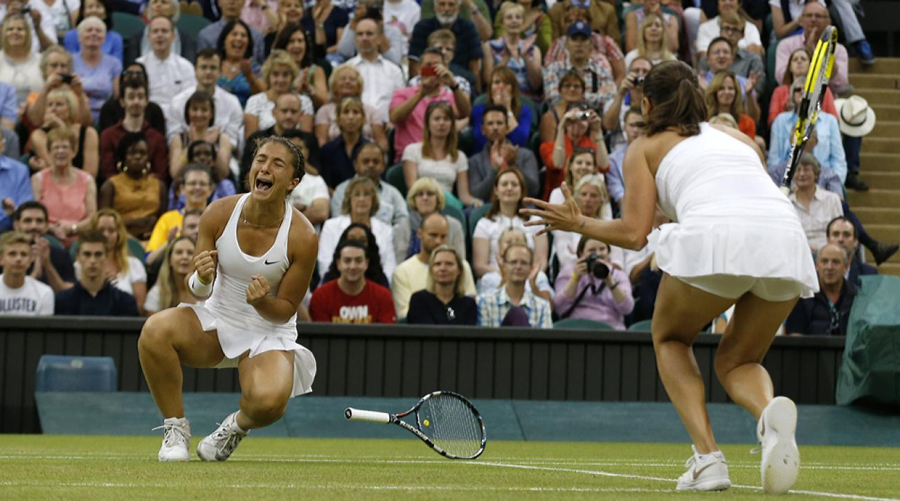 Sara Errani and Roberta Vinci defeated Kristina Mladenovic and Timea Babos to win their first Wimbledon doubles title.