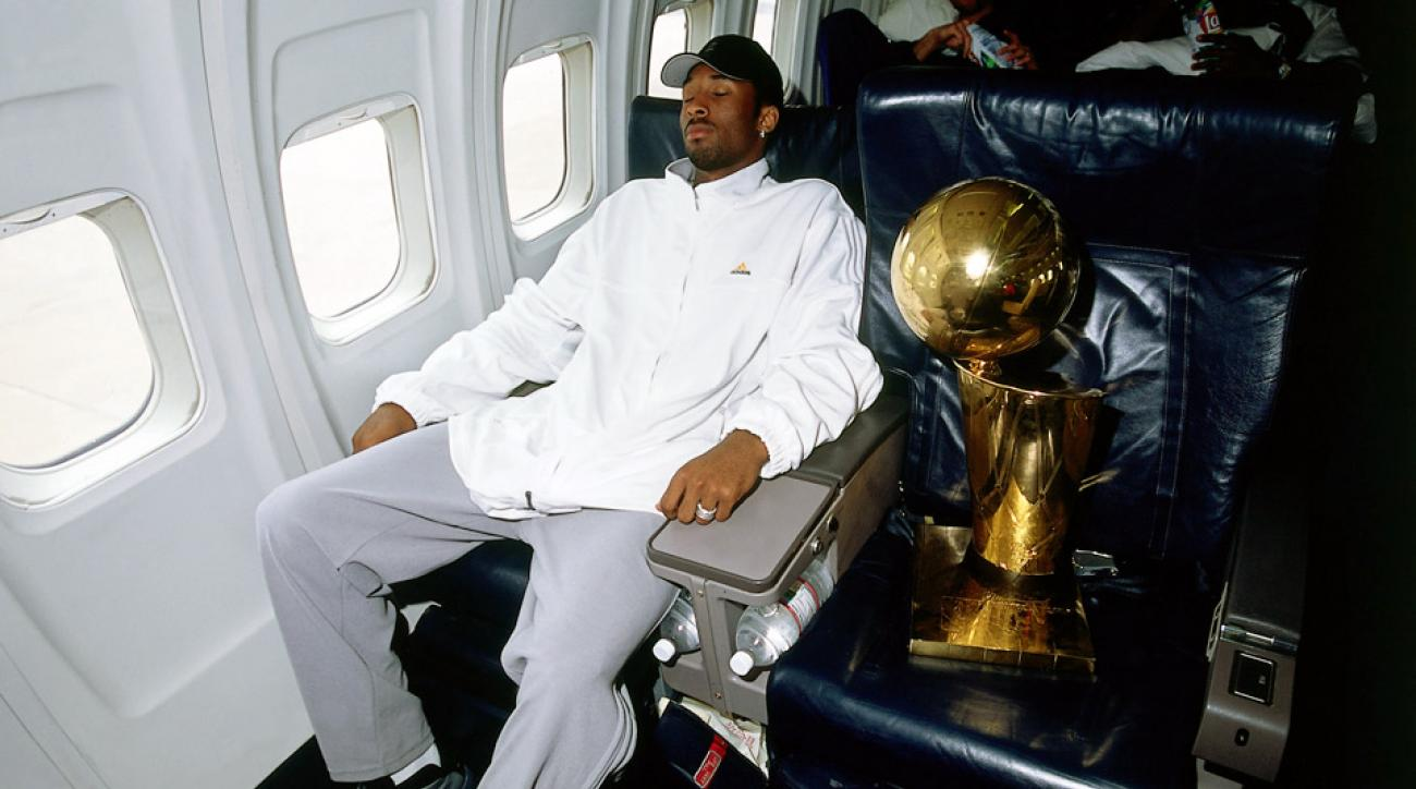 Los Angeles Lakers star Kobe Bryant takes a nap on the team flight home from Philadelphia after beating the 76ers to win the 2001 NBA Championship.