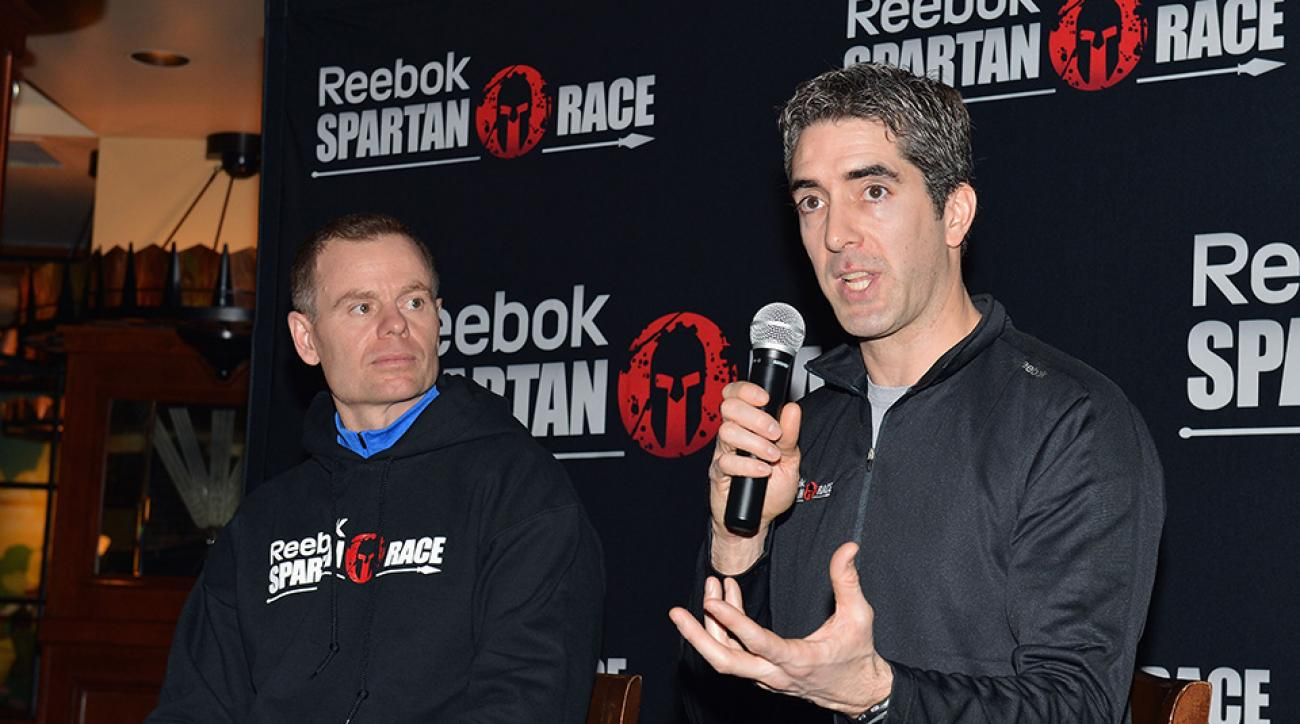 Joe De Sena (left), Spartan Race CEO and Yan Martin (right), Head of Global Brand Marketing at Reebok attend the Spartan Race 2013 Launch in New York City.