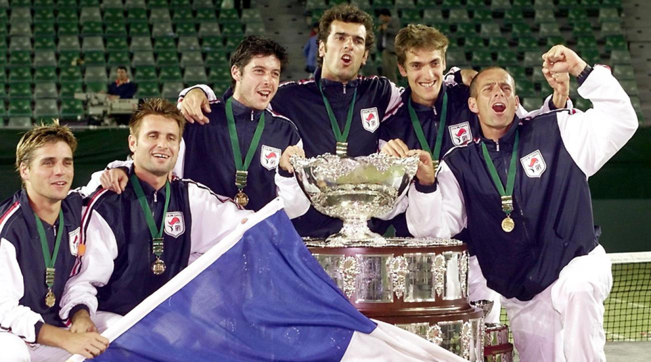 The French Davis Cup team of Arnaud Clement (L), Fabrice Santoro (2/L) Sebastien Grosjean (C), Cedric Pioline (3/R), Nicolas Escude (2/R) and team captain Guy Forget (R) celebrate with the trophy after winning the Davis Cup final.
