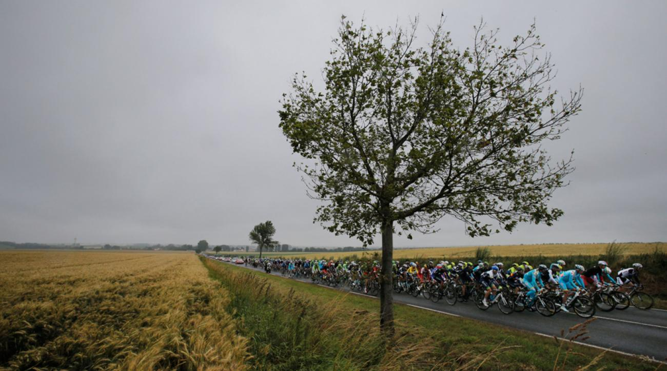 The pack rides under a grey sky during the sixth stage of the Tour de France with the start in Arras and finish in Reims, France, Thursday, July 10, 2014.
