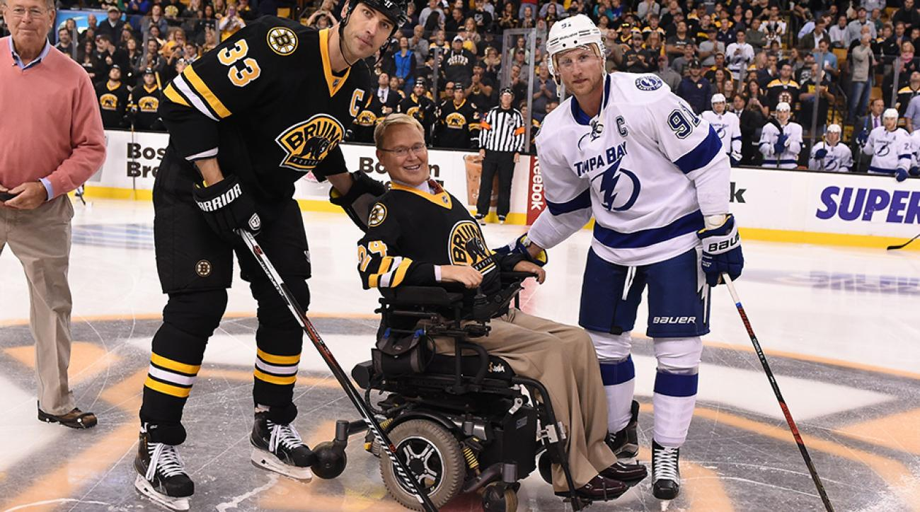 Travis Roy drops the puck at center ice before the game with Zdeno Chara of the Boston Bruins and Steven Stamkos of the Tampa Bay Lightning at the TD Garden on October 2015.