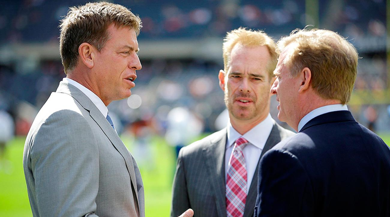 Troy Aikman (left) and Joe Buck (center) speak with NFL commissioner Roger Goodell.