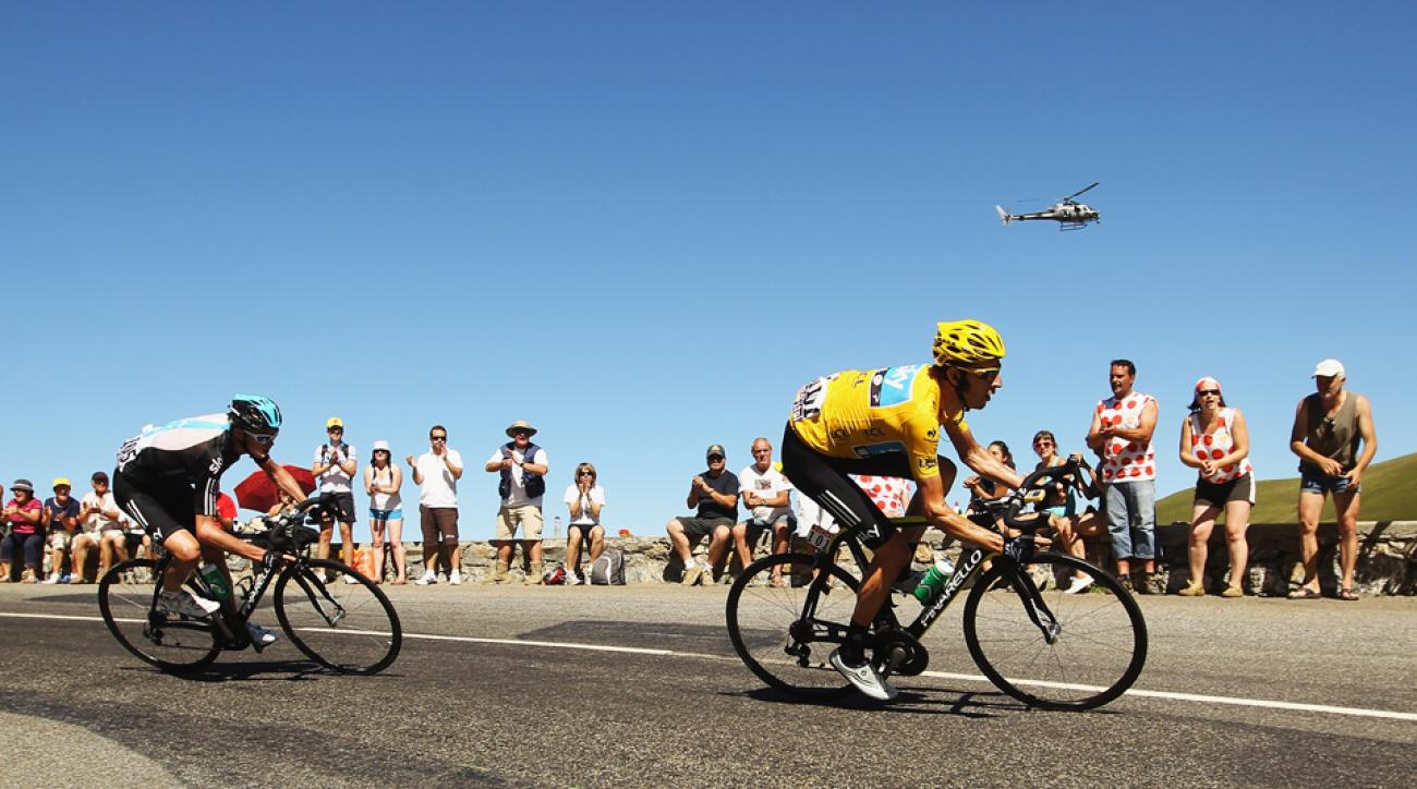 Bradley Wiggins (R) and Team SKY leads teammate Chris Froome (L) on the descent of the Col de Peyresourde on stage sixteen during the 2012 Tour de France from Pau to Bagneres-de-Luchon.