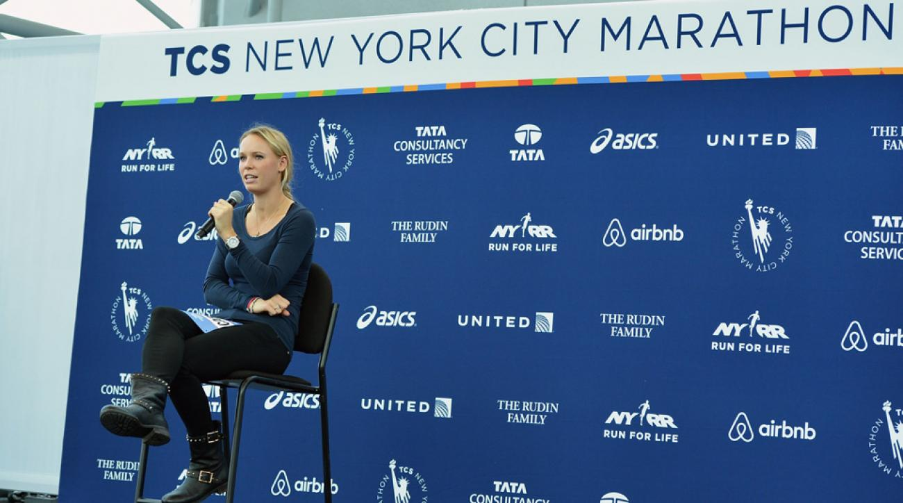 Tennis star Caroline Wozniacki stops by the Jacob K. Javits Convention Center to pick up her NYC Marathon official race bib.