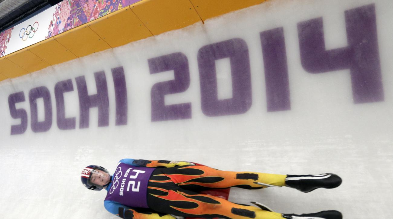 Tucker West of the United States takes a turn during a training session for the men's singles luge at the 2014 Winter Olympics, Thursday, Feb. 6, 2014, in Krasnaya Polyana, Russia. (AP Photo/Michael Sohn)