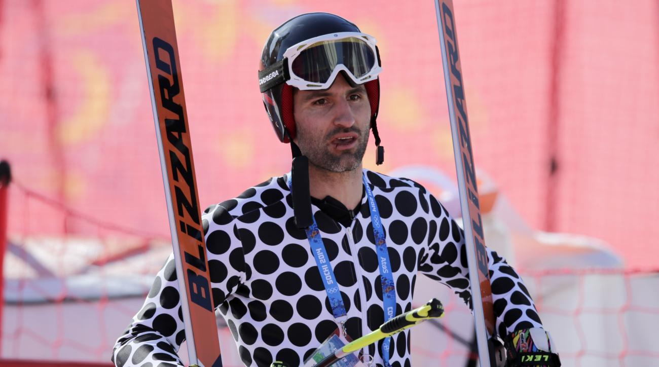 Argentina's Cristian Javier Simari Birkner carries his skis in the finish area after a men's downhill training run for the Sochi 2014 Winter Olympics, Friday, Feb. 7, 2014, in Krasnaya Polyana, Russia. (AP Photo/Gero Breloer)