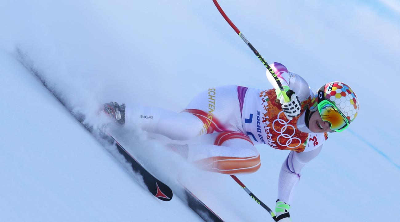 Liechtenstein's Tina Weirather makes a turn in a women's downhill training run for the Sochi 2014 Winter Olympics, Friday, Feb. 7, 2014, in Krasnaya Polyana, Russia. (AP Photo/Alessandro Trovati)