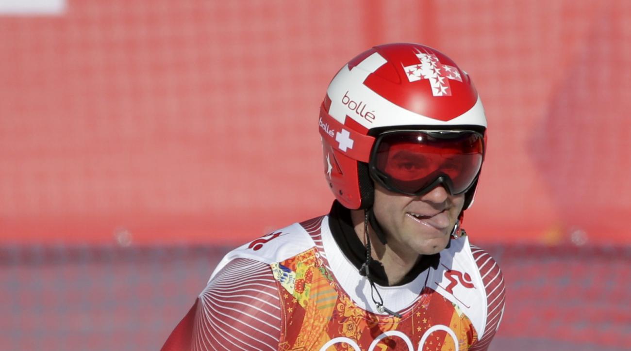 Switzerland's Didier Defago arrives in the finish area after a men's downhill training run for the Sochi 2014 Winter Olympics, Saturday, Feb. 8, 2014, in Krasnaya Polyana, Russia. (AP Photo/Gero Breloer)
