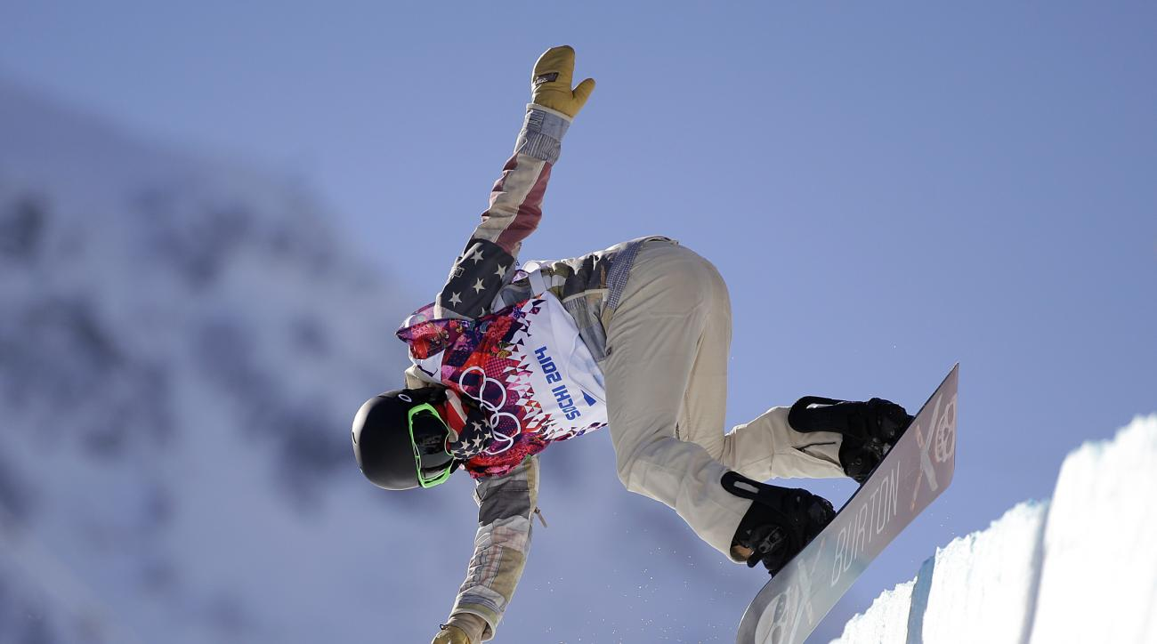 Shaun White of the United States jumps during a training session for the men's snowboard halfpipe at the 2014 Winter Olympics, Saturday, Feb. 8, 2014, in Krasnaya Polyana, Russia. (AP Photo/Jae C. Hong)