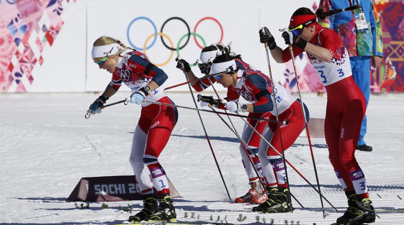 Norway's Therese Johaug, Norway's Marit Bjoergen and Poland's Justyna Kowalczyk, from left, start the women's 15k skiathlon at the 2014 Winter Olympics, Saturday, Feb. 8, 2014, in Krasnaya Polyana, Russia. (AP Photo/Dmitry Lovetsky)