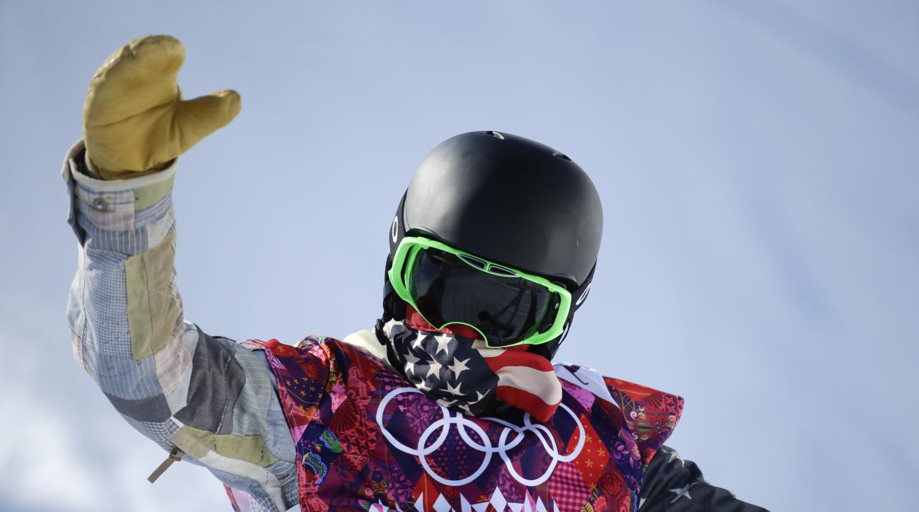 Shaun White of the United States lands from a jump during a training session for the men's snowboard halfpipe at the 2014 Winter Olympics, Saturday, Feb. 8, 2014, in Krasnaya Polyana, Russia. (AP Photo/Jae C. Hong)
