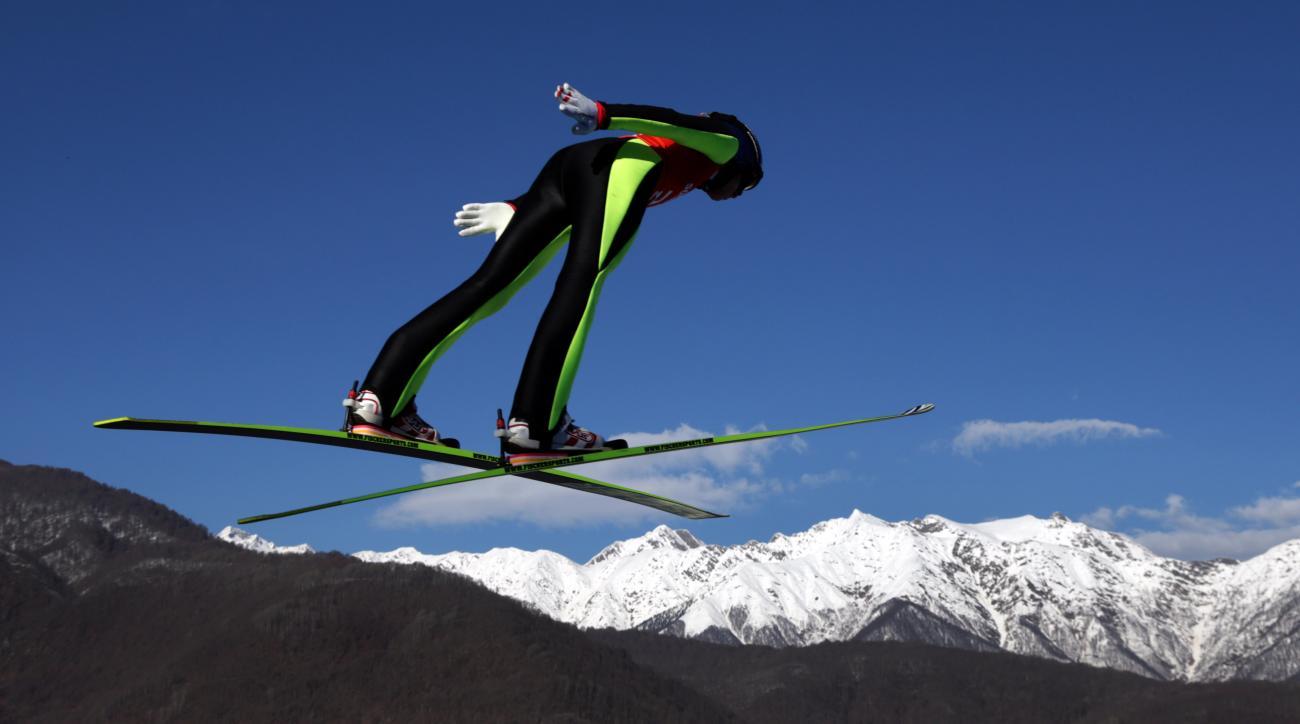 Austria's Daniela Iraschko-Stolz soars through the air during a women's ski jumping training session at the 2014 Winter Olympics, Saturday, Feb. 8, 2014, in Krasnaya Polyana, Russia. (AP Photo/Matthias Schrader)