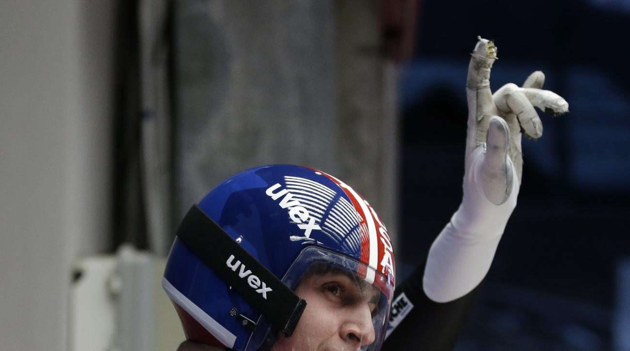 Christopher Mazdzer of the United States waves to fans after finishing his first run during the men's singles luge competition at the 2014 Winter Olympics, Saturday, Feb. 8, 2014, in Krasnaya Polyana, Russia. (AP Photo/Dita Alangkara)