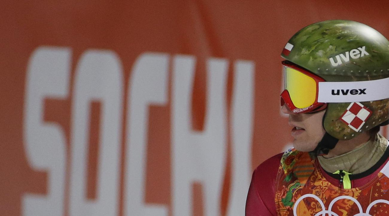 Poland's Kamil Stoch checks the scoreboard after an attempt during the men's normal hill ski jumping qualification at the 2014 Winter Olympics, Saturday, Feb. 8, 2014, in Krasnaya Polyana, Russia. (AP Photo/Gregorio Borgia)