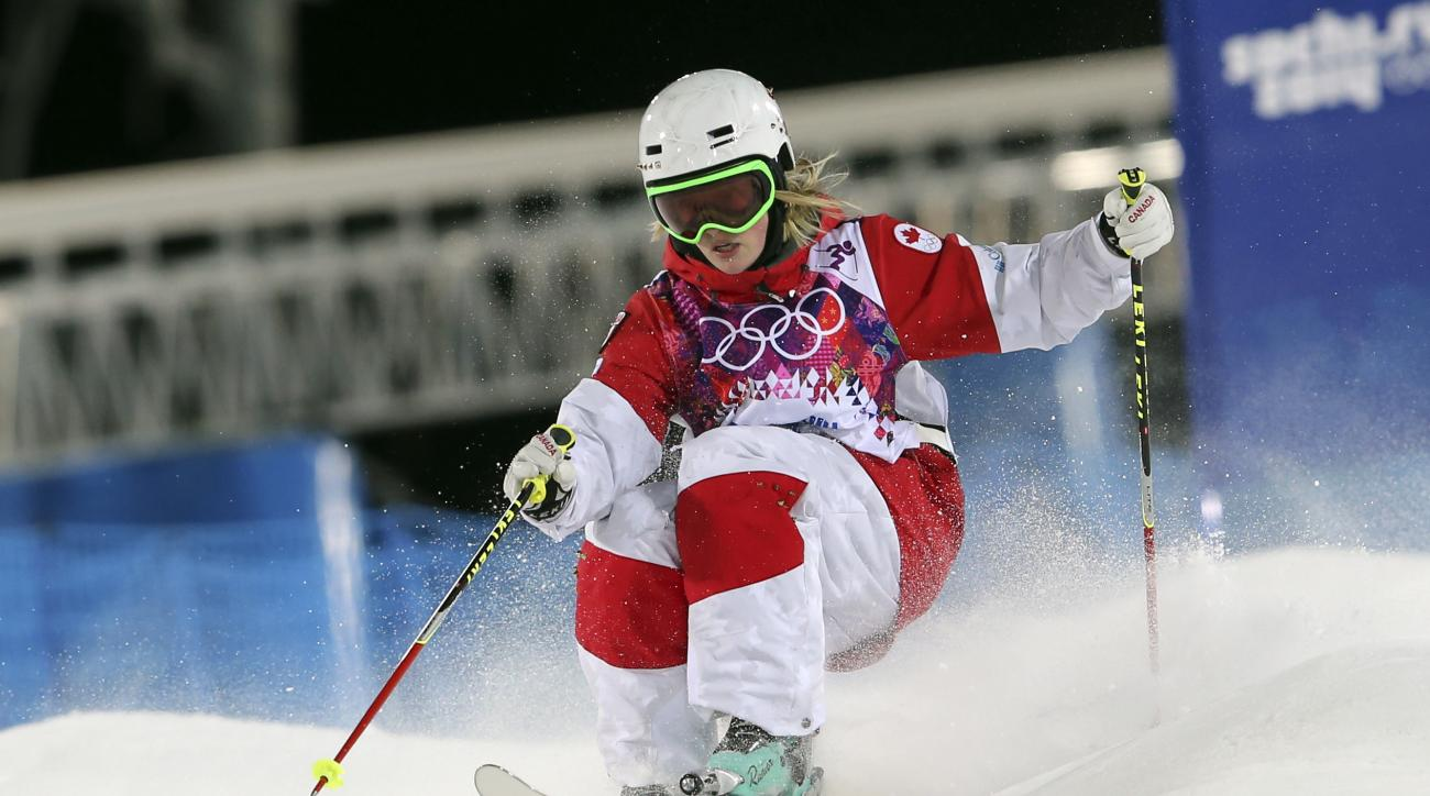 Canada's Justine Dufour-Lapointe competes in the women's moguls final 1 at the Rosa Khutor Extreme Park, at the 2014 Winter Olympics, Saturday, Feb. 8, 2014, in Krasnaya Polyana, Russia.(AP Photo/Sergei Grits)