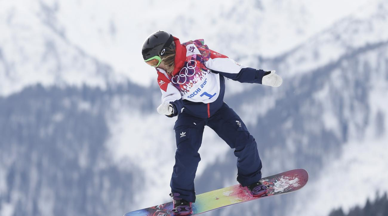 Britain's Jenny Jones jumps during the women's snowboard slopestyle semifinal at the 2014 Winter Olympics, Sunday, Feb. 9, 2014, in Krasnaya Polyana, Russia. (AP Photo/Andy Wong)