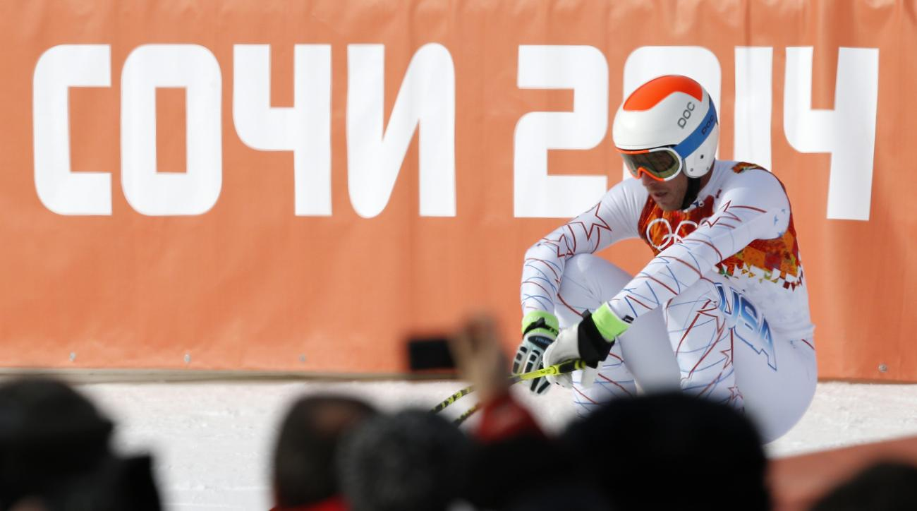 United States' Bode Miller reacts after finishing the men's downhill at the Sochi 2014 Winter Olympics, Sunday, Feb. 9, 2014, in Krasnaya Polyana, Russia. (AP Photo/Christophe Ena)