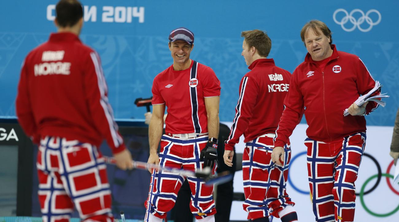 Norway skip Thomas Ulsrud, second from left, and teammate Torger Nergaard, second from right, share a laugh during a men's curling training session the 2014 Winter Olympics, Sunday, Feb. 9, 2014, in Sochi, Russia. At right is coach Paal Trulsen. (AP Photo/Robert F. Bukaty)