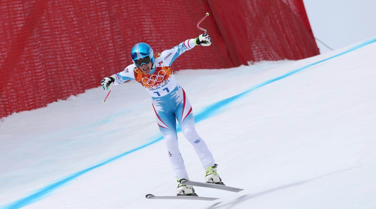 Austria's Matthias Mayer neats the finish to win gold in the men's downhill at the Sochi 2014 Winter Olympics, Sunday, Feb. 9, 2014, in Krasnaya Polyana, Russia.(AP Photo/Luca Bruno)