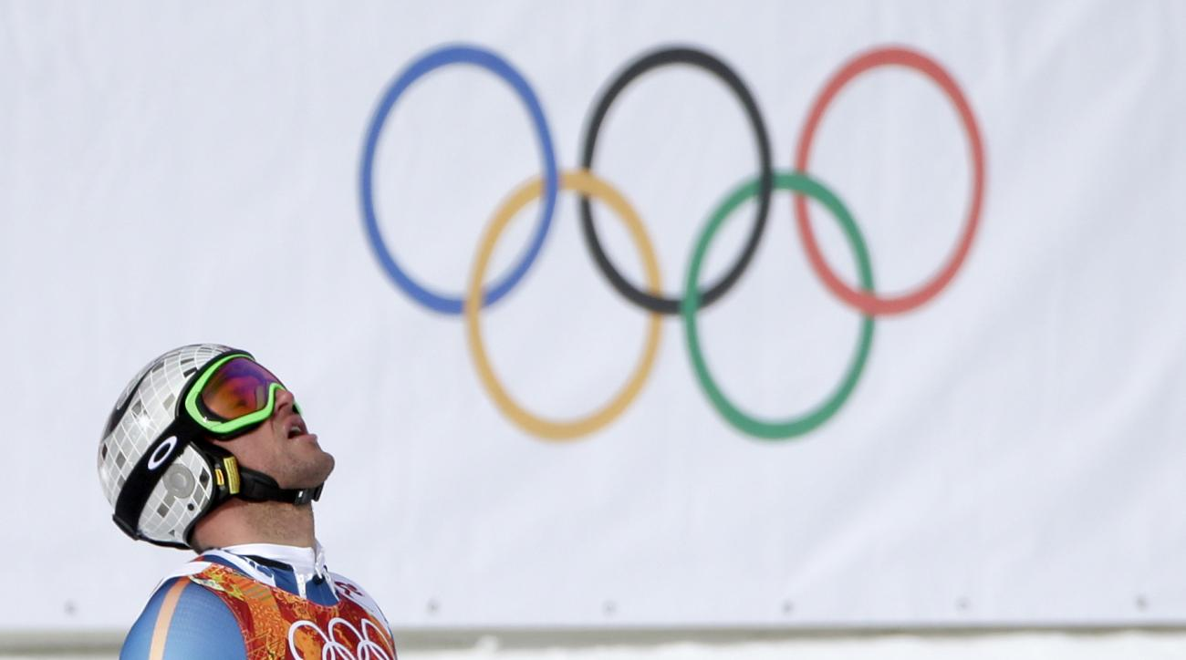 Norway's Aksel Lund Svindal reacts after finishing the men's downhill at the Sochi 2014 Winter Olympics, Sunday, Feb. 9, 2014, in Krasnaya Polyana, Russia. (AP Photo/Gero Breloer)