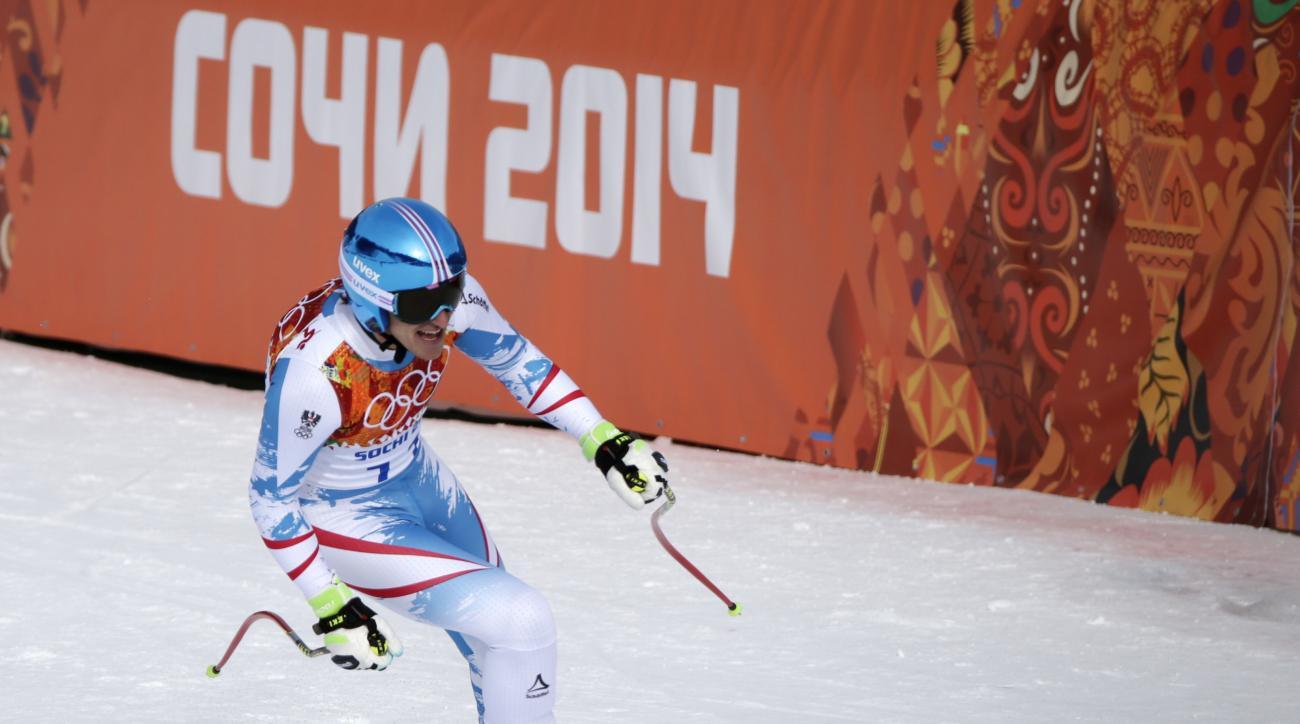 Austria's Matthias Mayer finishes to win the gold in the men's downhill at the Sochi 2014 Winter Olympics, Sunday, Feb. 9, 2014, in Krasnaya Polyana, Russia. (AP Photo/Gero Breloer)