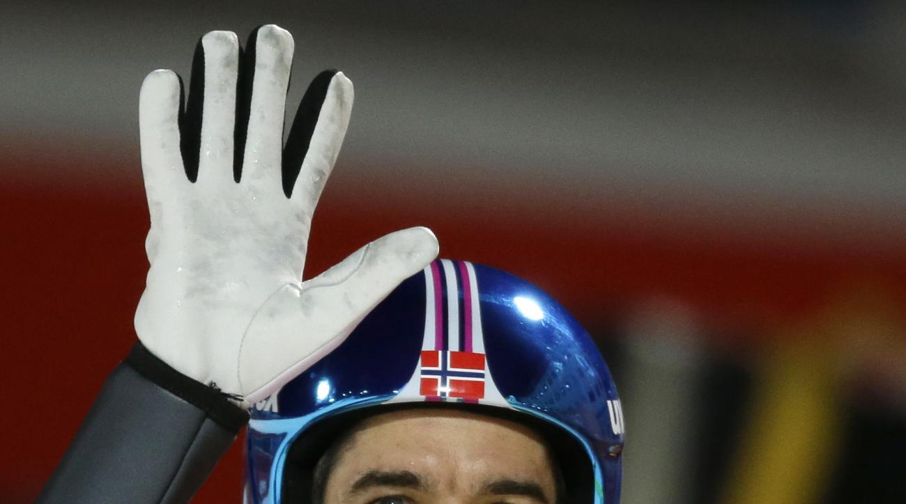 Norway's Anders Bardal waves to fans after his first attempt during the men's normal hill ski jumping final at the 2014 Winter Olympics, Sunday, Feb. 9, 2014, in Krasnaya Polyana, Russia. (AP Photo/Gregorio Borgia)