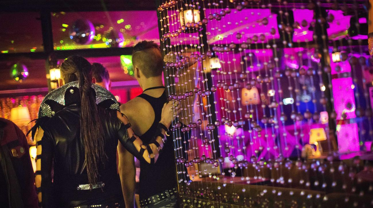 In this photo taken Saturday, Feb. 8, 2014, workers wait for customers to arrive before a performance at the Mayak cabaret, the most reputable gay club in Sochi, Russia, host to 2014 Winter Olympics. Russia adopted a law last year, prohibiting vaguely defined propaganda of non-traditional sexual relations and pedophilia. The legislation makes it illegal to disseminate information to children even if it merely shows that gay people are just like everybody else. At Mayak, packed on Saturday night, gay men and women steered away from discussing the law, preferring to enjoy life, closeted as it is. About a hundred people were chatting at the bar, sitting in armchairs or dancing. Couples were sharing kisses. Everyone was waiting for the club's specialty: a drag show. At 1.30 a.m. on Sunday, the music stopped and the show began. (AP Photo/David Goldman)
