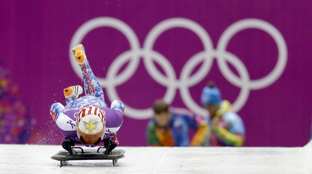 Katie Uhlaender of the United States starts a training run for the women's skeleton during the 2014 Winter Olympics, Monday, Feb. 10, 2014, in Krasnaya Polyana, Russia. (AP Photo/Natacha Pisarenko)