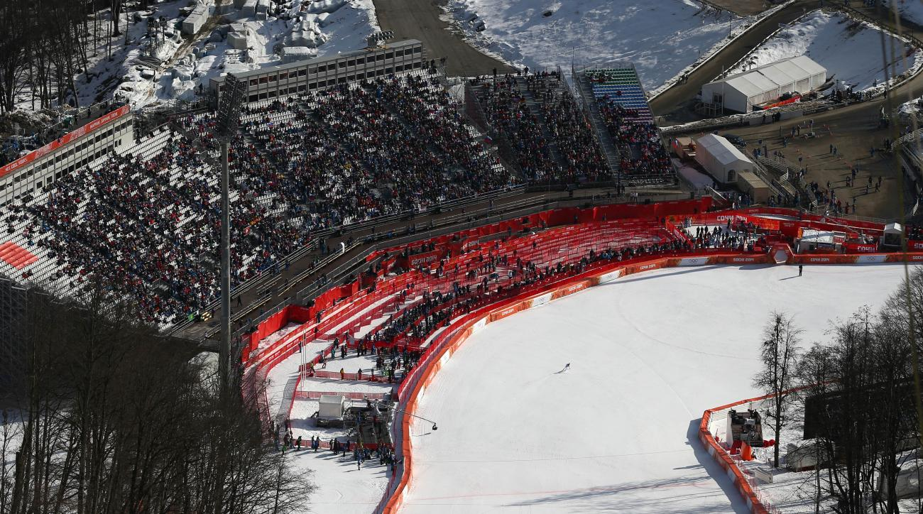 United States' Julia Mancuso finishes in the downhill portion of the women's supercombined at the Sochi 2014 Winter Olympics, Monday, Feb. 10, 2014, in Krasnaya Polyana, Russia. (AP Photo/Alessandro Trovati)
