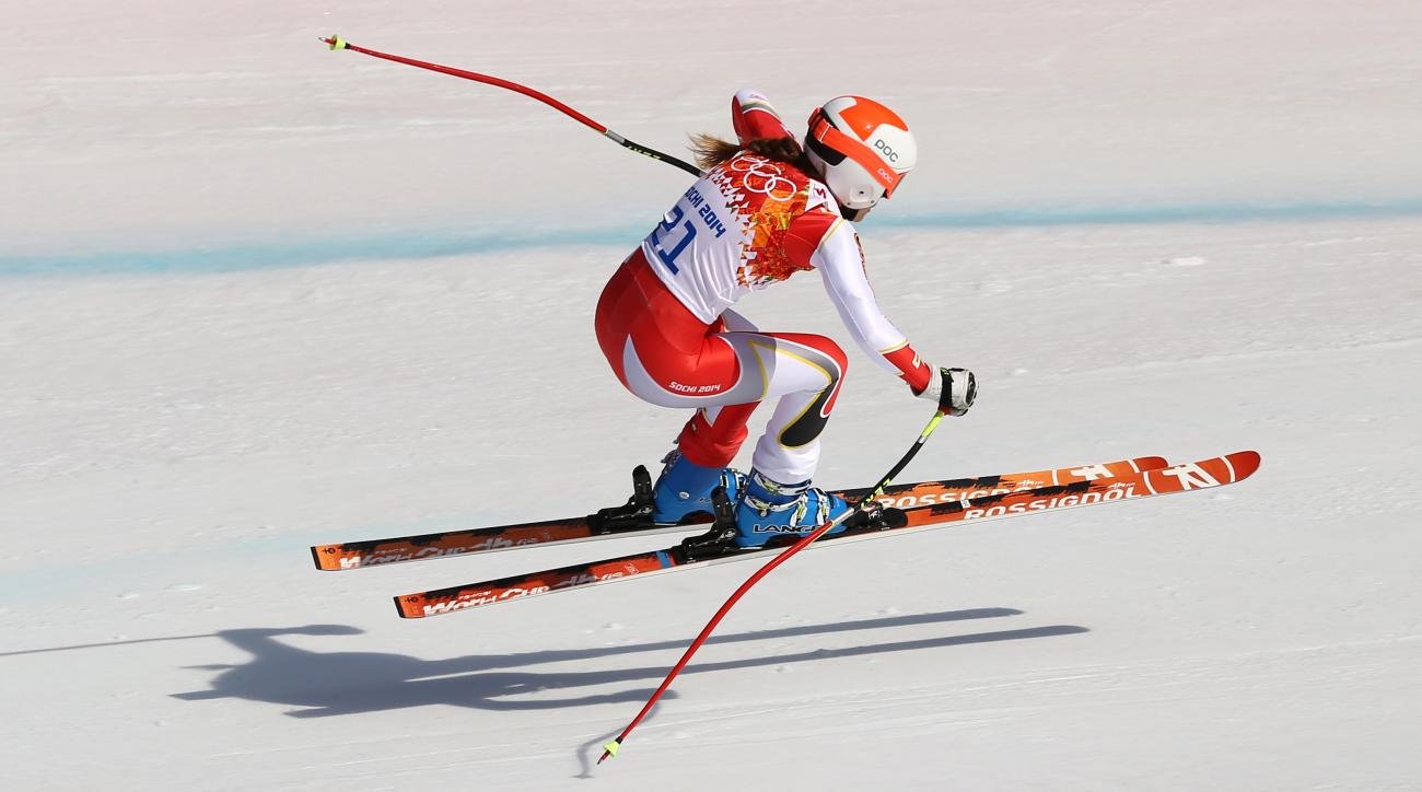 Canada's Marie-Michele Gagnon makes a jump during the downhill portion of the women's supercombined at the Sochi 2014 Winter Olympics, Monday, Feb. 10, 2014, in Krasnaya Polyana, Russia. (AP Photo/Alessandro Trovati)