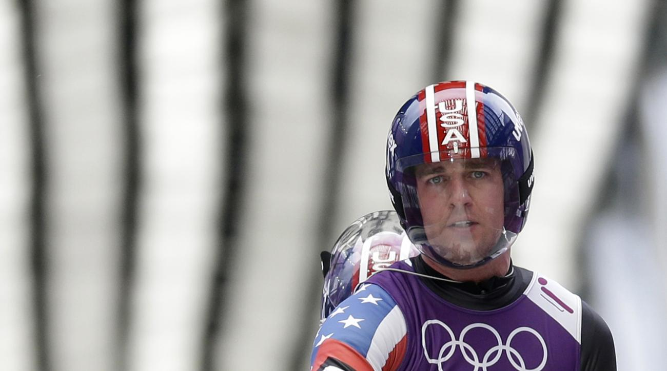 The doubles team of Christian Niccum and Jayson Terdiman of the United States brake in the finish area during the men's doubles luge training session at the 2014 Winter Olympics, Monday, Feb. 10, 2014, in Krasnaya Polyana, Russia. (AP Photo/Natacha Pisarenko)