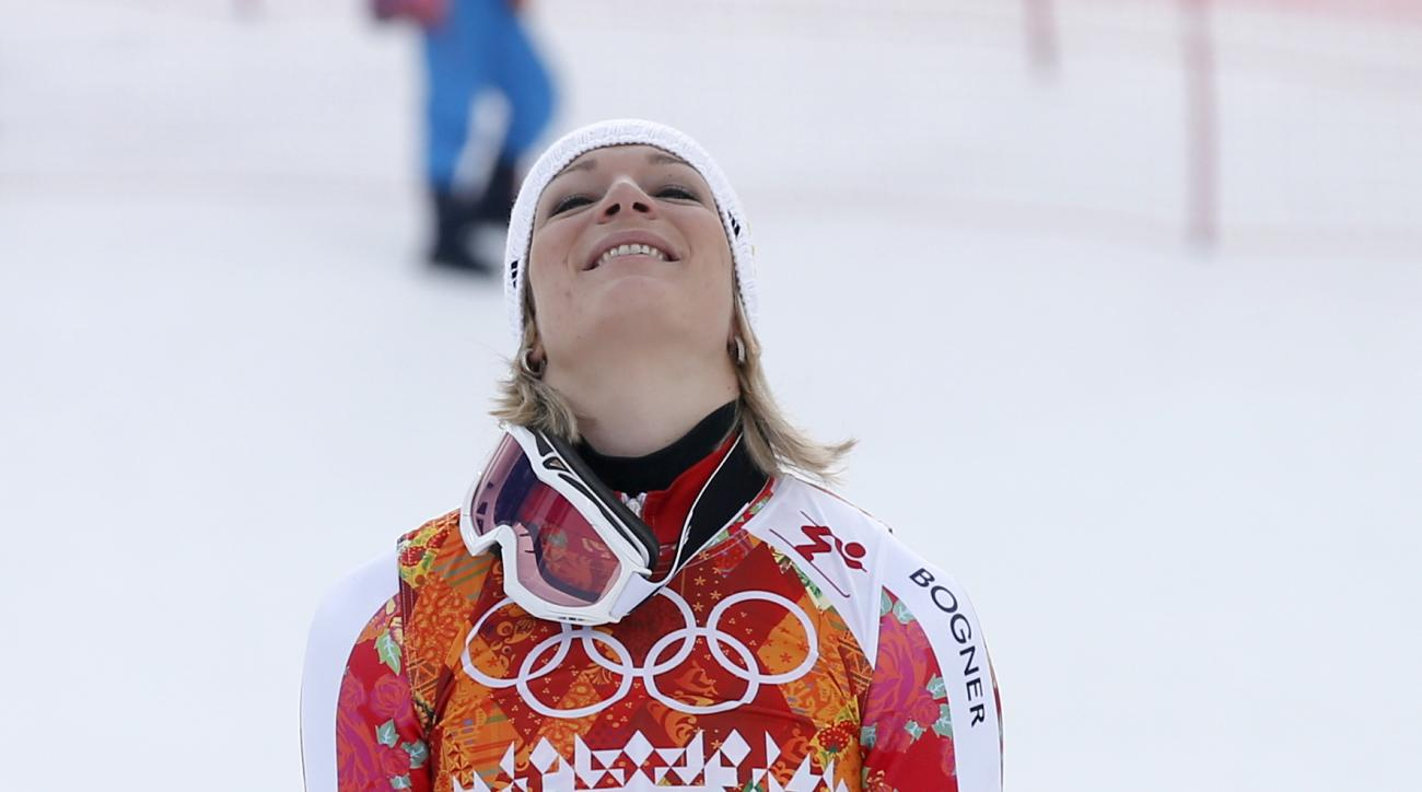 Germany's Maria Hoefl-Riesch stands on the podium during a flower ceremony after she won the gold medal in the women's supercombined at the Sochi 2014 Winter Olympics, Monday, Feb. 10, 2014, in Krasnaya Polyana, Russia. (AP Photo/Christophe Ena)