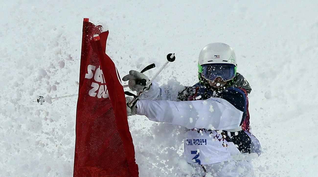 Patrick Deneen of the United States hits a flag during the men's moguls qualifying at the Rosa Khutor Extreme Park at the 2014 Winter Olympics, Monday, Feb. 10, 2014, in Krasnaya Polyana, Russia. (AP Photo/Andy Wong)