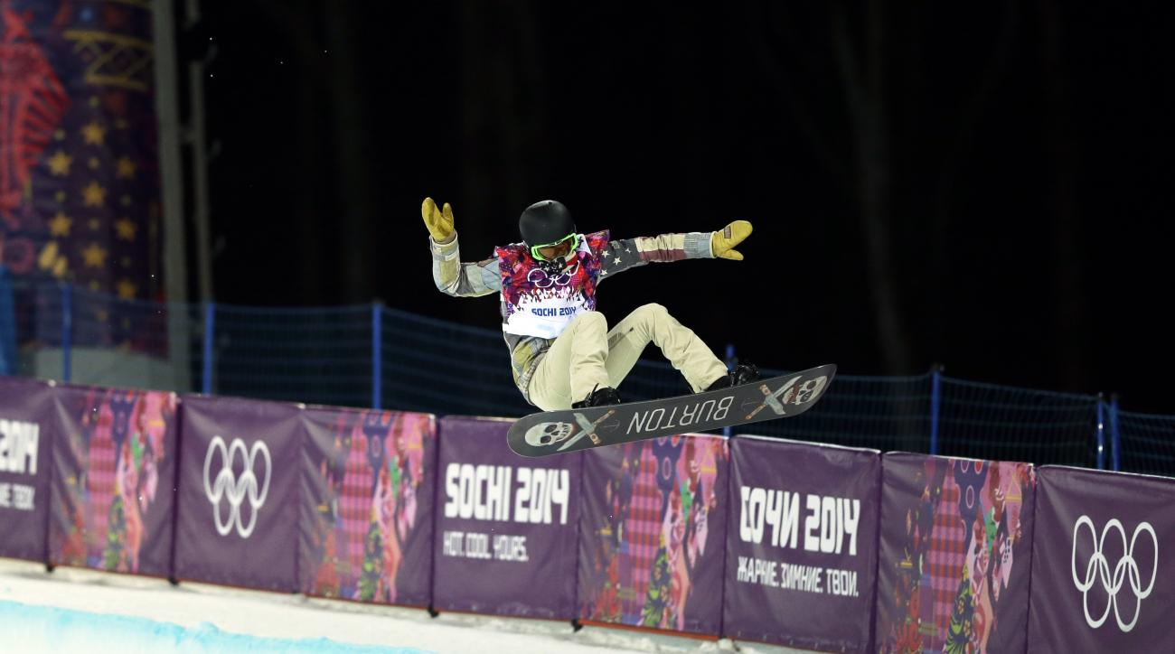 Shaun White of the United States gets air during a snowboard half pipe training session at the Rosa Khutor Extreme Park at the 2014 Winter Olympics, Monday, Feb. 10, 2014, in Krasnaya Polyana, Russia.  (AP Photo/Andy Wong)