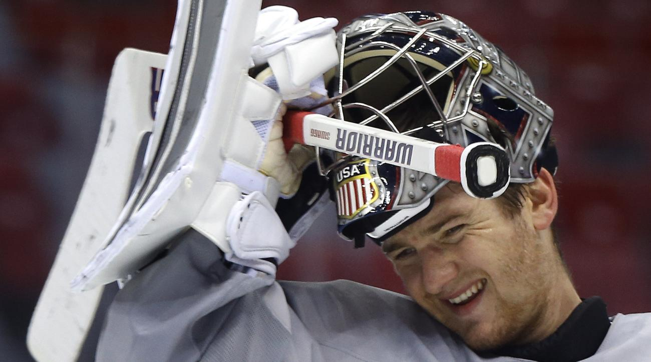 USA goaltender Jonathan Quick pulls his helmet down during a training session at the 2014 Winter Olympics, Monday, Feb. 10, 2014, in Sochi, Russia. (AP Photo/Julie Jacobson)