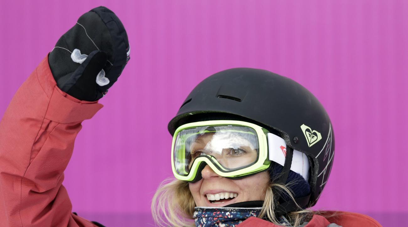 Canada's Dara Howell reacts after a run in the women's freestyle skiing slopestyle qualifying at the Rosa Khutor Extreme Park at the 2014 Winter Olympics, Tuesday, Feb. 11, 2014, in Krasnaya Polyana, Russia. (AP Photo/Andy Wong)