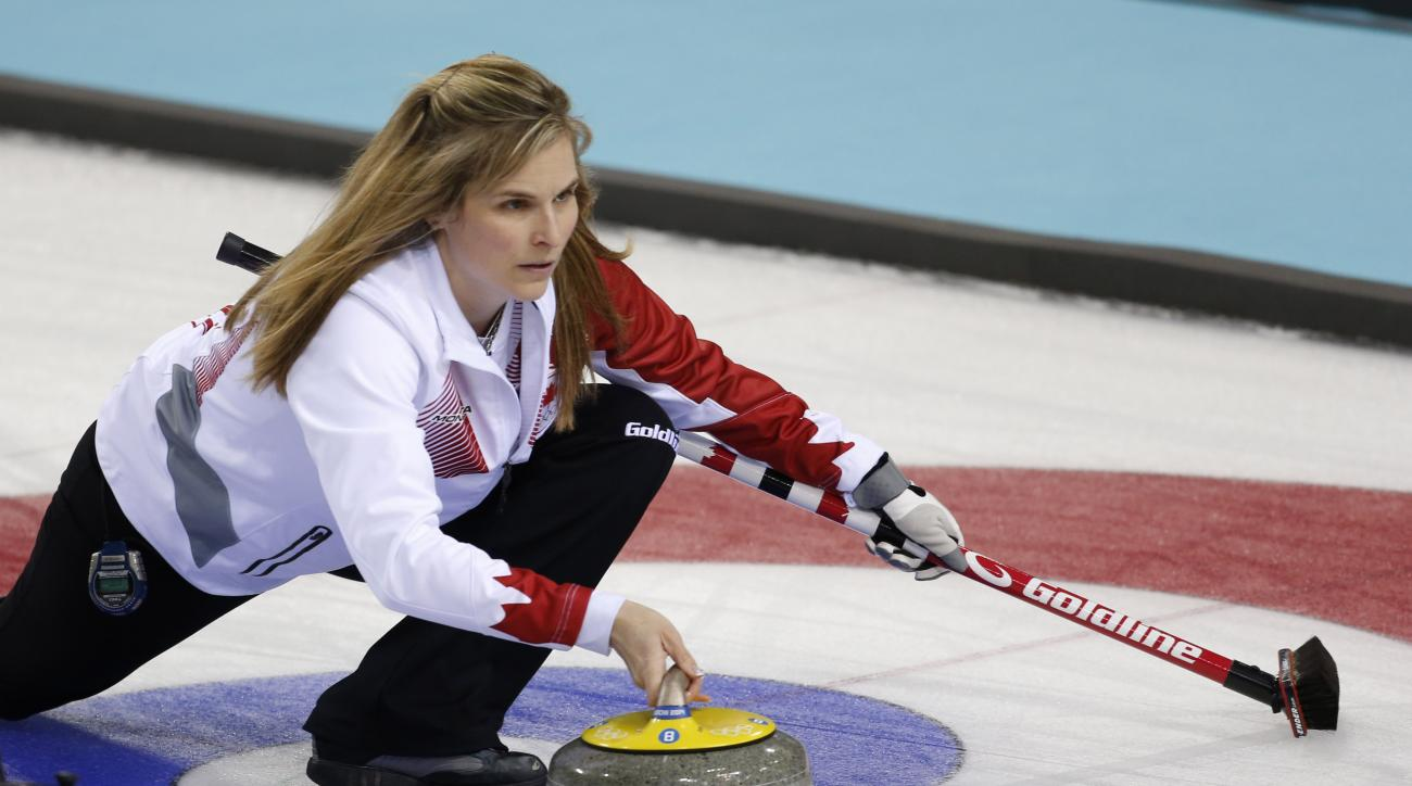 Canada's skip Jennifer Jones delivers the rock to her during women's curling competition against Sweden at the 2014 Winter Olympics, Tuesday, Feb. 11, 2014, in Sochi, Russia. (AP Photo/Robert F. Bukaty)