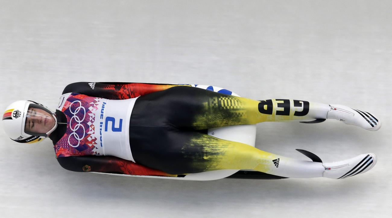 Natalie Geisenberger of Germany speeds down the track in her third run during the women's singles luge competition at the 2014 Winter Olympics, Tuesday, Feb. 11, 2014, in Krasnaya Polyana, Russia. (AP Photo/Michael Sohn)