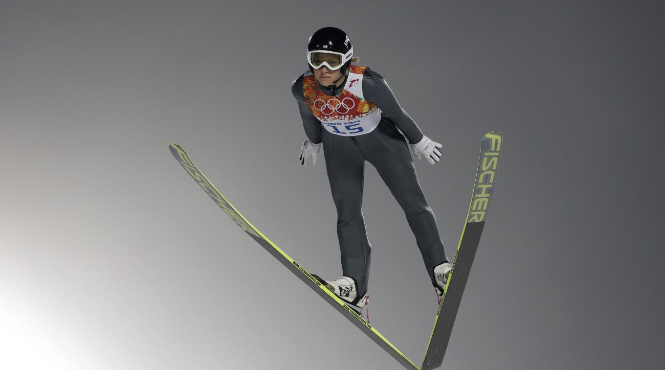United States' Jessica Jerome makes her trial jump in the women's ski jumping normal hill final at the 2014 Winter Olympics, Tuesday, Feb. 11, 2014, in Krasnaya Polyana, Russia. (AP Photo/Matthias Schrader)