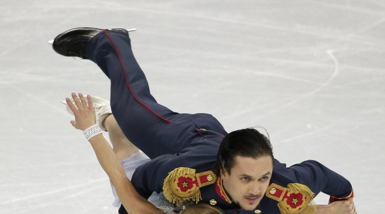 Tatiana Volosozhar and Maxim Trankov of Russia compete in the pairs short program figure skating competition at the Iceberg Skating Palace during the 2014 Winter Olympics, Tuesday, Feb. 11, 2014, in Sochi, Russia. (AP Photo/Bernat Armangue)