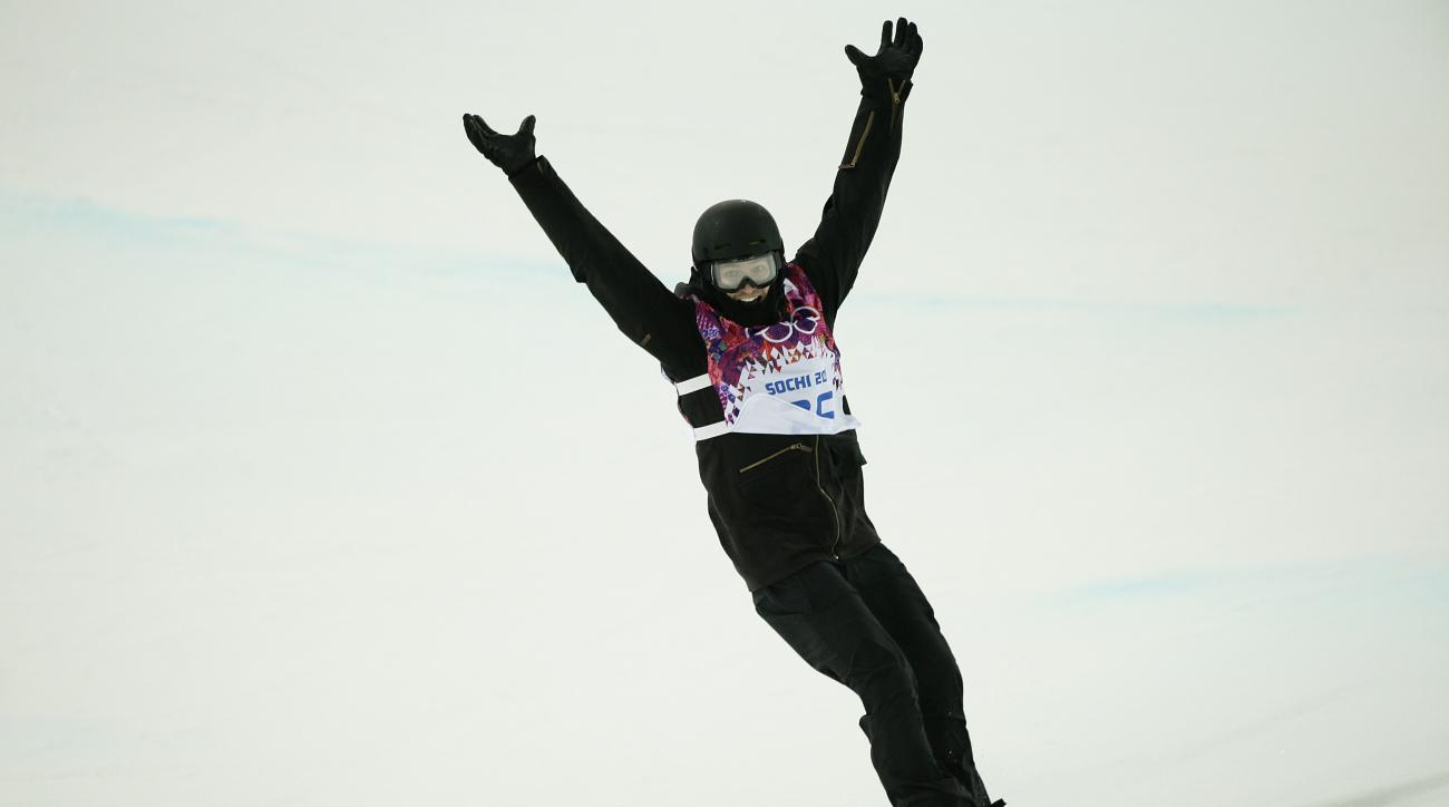 Switzerland's Iouri Podladtchikov reacts after competing in the men's snowboard halfpipe final at the Rosa Khutor Extreme Park, at the 2014 Winter Olympics, Tuesday, Feb. 11, 2014, in Krasnaya Polyana, Russia. Podladtchikov won the gold medal. (AP Photo/Jae C. Hong)