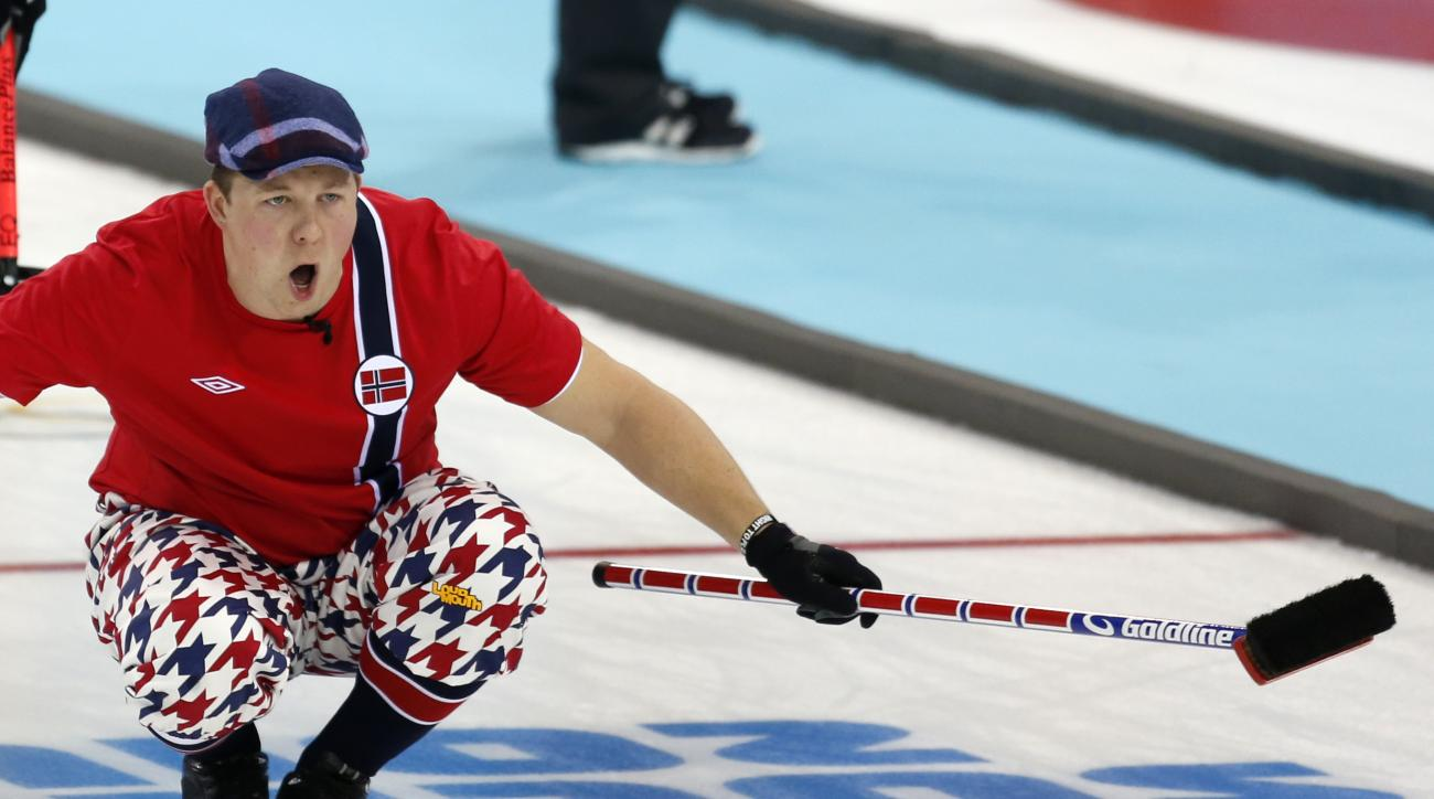 Norway's Christoffer Svae shouts sweeping instructions after delivering the rock during men's curling competition against Germany at the 2014 Winter Olympics, Wednesday, Feb. 12, 2014, in Sochi, Russia. (AP Photo/Robert F. Bukaty)