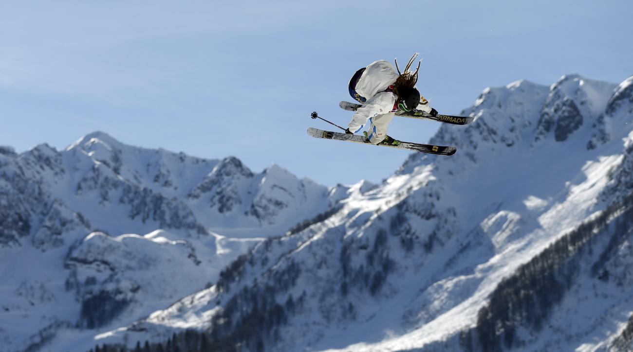 Sweden's Henrik Harlaut is airborne  during mens ski slopestyle training at the Rosa Khutor Extreme Park, at the 2014 Winter Olympics, Wednesday, Feb. 12, 2014, in Krasnaya Polyana, Russia. (AP Photo/Felipe Dana)